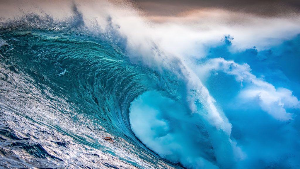 Huge wave crashing with amazing light at sunset