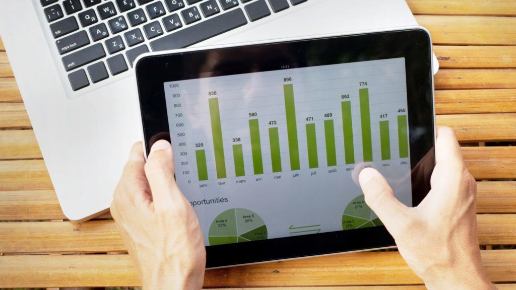 hands of farmer with tablet with infographics on the screen