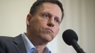 Peter Thiel, PayPal founder-turned-venture-capitalist, discusses his support for US Republican presidential nominee Donald Trump, at the National Press Club in Washington, DC, October 31, 2016. / AFP PHOTO / SAUL LOEB