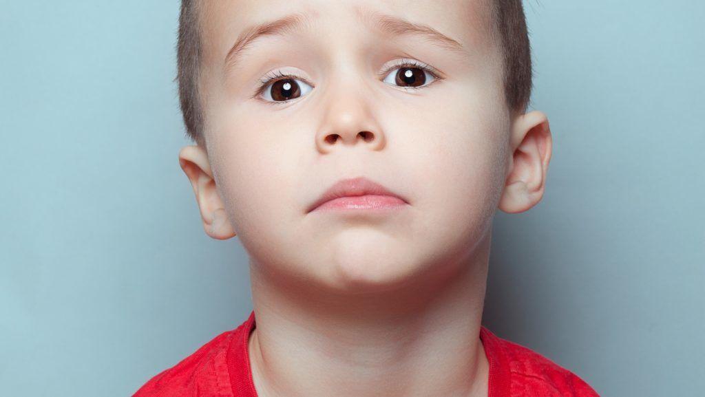 Portrait of a shocked boy