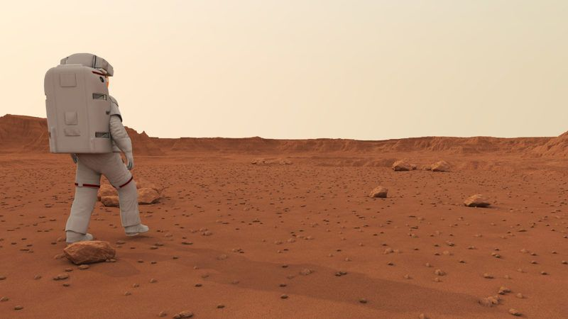 Astronaut walking on planet, illustration.