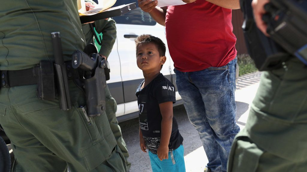 """MISSION, TX - JUNE 12: A boy and father from Honduras are taken into custody by U.S. Border Patrol agents near the U.S.-Mexico Border on June 12, 2018 near Mission, Texas. The asylum seekers were then sent to a U.S. Customs and Border Protection (CBP) processing center for possible separation. U.S. border authorities are executing the Trump administration's """"zero tolerance"""" policy towards undocumented immigrants. U.S. Attorney General Jeff Sessions also said that domestic and gang violence in immigrants' country of origin would no longer qualify them for political asylum status.   John Moore/Getty Images/AFP"""