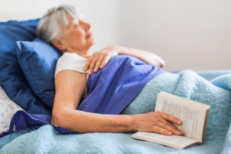 Woman sleeping in bed.  Paris, France   BURGER/PHANIE