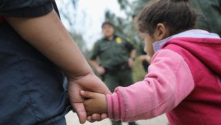 (FILES) In this file photo taken on January 04, 2017 U.S. Border Patrol agents take Central American immigrants into custody near McAllen, Texas. Nearly 2,000 minors were separated from their parents or adult guardians who illegally crossed into the United States over a recent six-week period, officials said Friday in the most comprehensive 2018 figures provided on family separations. / AFP PHOTO / GETTY / JOHN MOORE