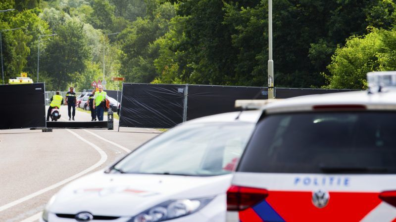 A picture taken near the site of the Pinkpop festival in Landgraaf, on June 18 2018, shows police cars after a van slammed into pedestrians, killing one and injuring three. The four pedestrians were hit around 4:00 am (0200 GMT) on June 18, 2018 by the van which then fled the scene, only hours after the end of the three-day Pinkpop Festival in the southern town of Landgraaf, near the German border. / AFP PHOTO / ANP / Piroschka van de Wouw / Netherlands OUT