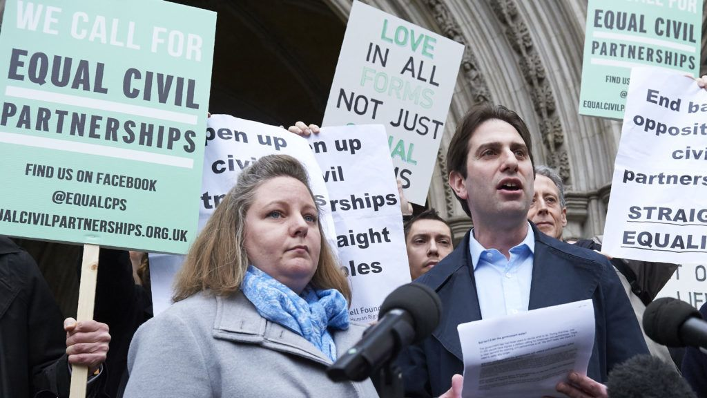 (FILES) In this file photo taken on February 21, 2017 Rebecca Steinfeld (L), and her partner Charles Keidan address the media outside the High Court in London. A heterosexual couple fighting to enter into a civil partnership -- created for gay couples in Britain -- won a legal challenge on June 27, 2018 to do so, opening the way for others to follow suit. Charles Keidan, 41, and 37-year-old Rebecca Steinfeld, academics in a long-term relationship but with ideological objections to marriage, argued that restricting civil partnerships to same-sex couples conflicts with equality law.  / AFP PHOTO / NIKLAS HALLE'N