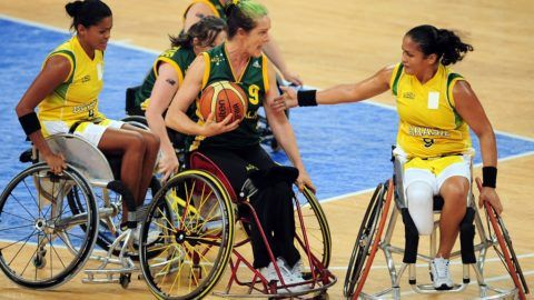 Australia's Liesl Tesch (C-#9) looks to pass under pressure from Brazil's Lia Soares Martins (R) in their wheelchair basketball preliminary match during the 2008 Beijing Paralympic Games at the National Indoor Stadium on September 8, 2008. Australia defeated Brazil 66-30.   AFP PHOTO / Frederic J. BROWN / AFP PHOTO / FREDERIC J. BROWN