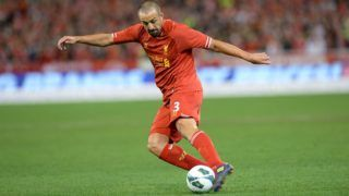 Liverpool's Jose Enrique dribbles the ball against the Melbourne Victory during their football friendly match at the MCG in Melbourne on July 24, 2013.     AFP PHOTO / Mal Fairclough       IMAGE STRICTLY RESTRICTED TO EDITORIAL USE - STRICTLY NO COMMERCIAL USE / AFP PHOTO / MAL FAIRCLOUGH