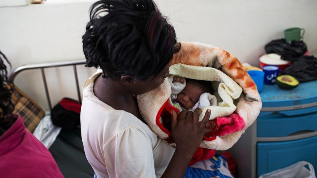 Lucia Kagotha holds her new born baby boy, named 'Obama' in honour of the US President Barack Obama, at the Mbagathi Hospital of Nairobi on July 26, 2015. US President Barack Obama wraps up a two-day landmark visit to Kenya on July 26, boosting business and security ties but with firm messages on gay rights and corruption. On July 26, Obama urged Kenya to renounce corruption and tribalism, delivering a rousing speech at the end of a landmark visit to the East African nation and birthplace of his father. AFP PHOTO / IVAN LIEMAN / AFP PHOTO / Ivan Lieman