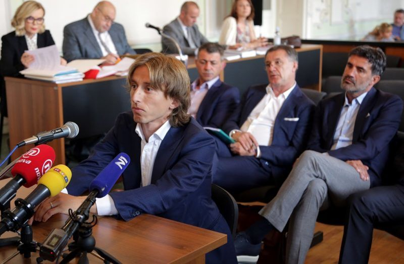 Croatia and Real Madrid midfielder Luka Modric appears in court to testify in a corruption trial in Osijek on June 13, 2017. Modric swapped his football kit for a suit as he appeared in the witness box to testify in a multi-million-euro corruption trial against Dinamo Zagreb's ex chairman. The 31-year-old star midfielder is to give evidence at the trial of controversial Zdravko Mamic, considered the most powerful man in Croatian football. / AFP PHOTO / STR