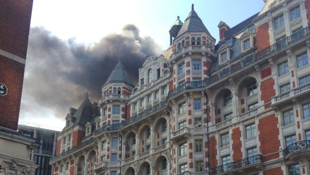 Plumes of black smoke billow as firefighters tackle a blaze at the Mandarin Oriental hotel in central London on June 6, 2018. A fire broke out at London's Mandarin Oriental hotel, with dozens of firefighters deployed to tackle the blaze that pumped smoke high into the air over the British capital