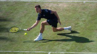 14 June 2018, Germany, Stuttgart, Tennis, 2018 ATP World Tour Stuttgart, Singles, Men, Raonic (Canada) vs Fucsovics (Hungary). Milos Raonic in action. Photo: Marijan Murat/dpa