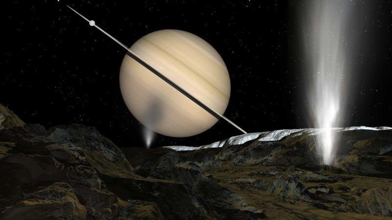 Geyser sur Encelade - Vue d'artiste - Water geyser on Enceladus - Artist view : Vue d'artiste d'un geyser de glace a la surface du satellite Encelade. Dans le ciel, la planete Saturne --- Liquid water reaches the surface of Enceladus' south pole and drives a massive plume of ice crystals into the sky ©Ron Miller/Novapix/Leemage