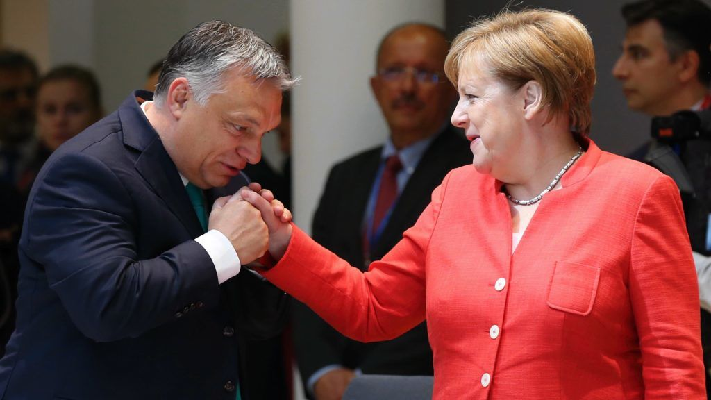 BRUSSELS, BELGIUM - JUNE 29: German Chancellor Angela Merkel (R) chats with Prime Minister of Hungary Viktor Orban (L) during the second day of the European Union Leaders' Summit in Brussels, Belgium on June 29, 2018.   Dursun Aydemir / Anadolu Agency