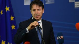 Giuseppe Conte, the 58th and current Prime Minister of Italy since 1 June 2018  talking to the press after an informal summit at the EU Commission in Brussels on June 24, 2018. - The leaders of France and Germany said that they were prepared to side-step anti-migrant EU members and do deals with individual countries on how to respond to a migrant influx that has caused deep splits in the bloc. The talks among 16 of the European Union's 28 leaders began after Italy's new populist government turned away another ship packed with migrants. (Photo by Wassilios Aswestopoulos/NurPhoto)