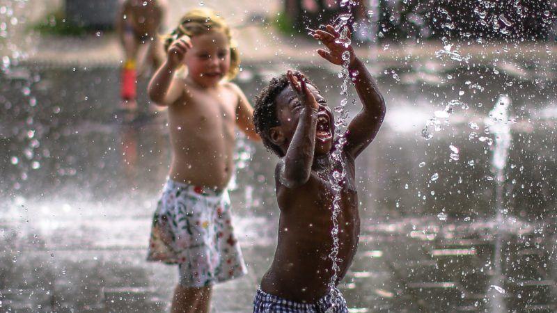 Children enjoy during a hot day in Amsterdam, Netherlands, on June 7, 2018. (Photo by Ezz al-Zanoun/NurPhoto)