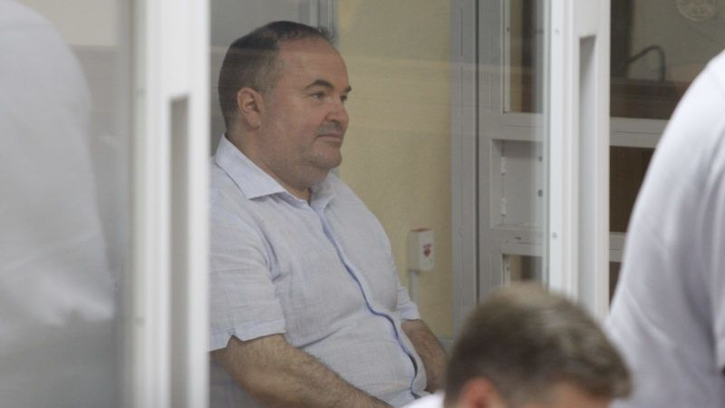 Boris German, who suspected of organizing an attempt on killing of Russian journalist Arkady Babchenko, sits in a cage during a court trial on a preventive punishment at the Shevchenkovsky district court in Kiev, Ukraine, 31 May 2018.  (Photo by STR/NurPhoto)