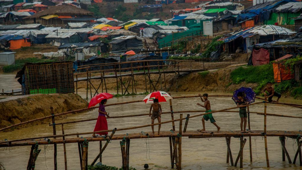 Four rohingya child playing on the bridge of a camp inside the kutupalong makeshift shelter in Cox's Bazar, Bangladesh on June 13, 2018. (Photo by Masfiqur Sohan/NurPhoto)