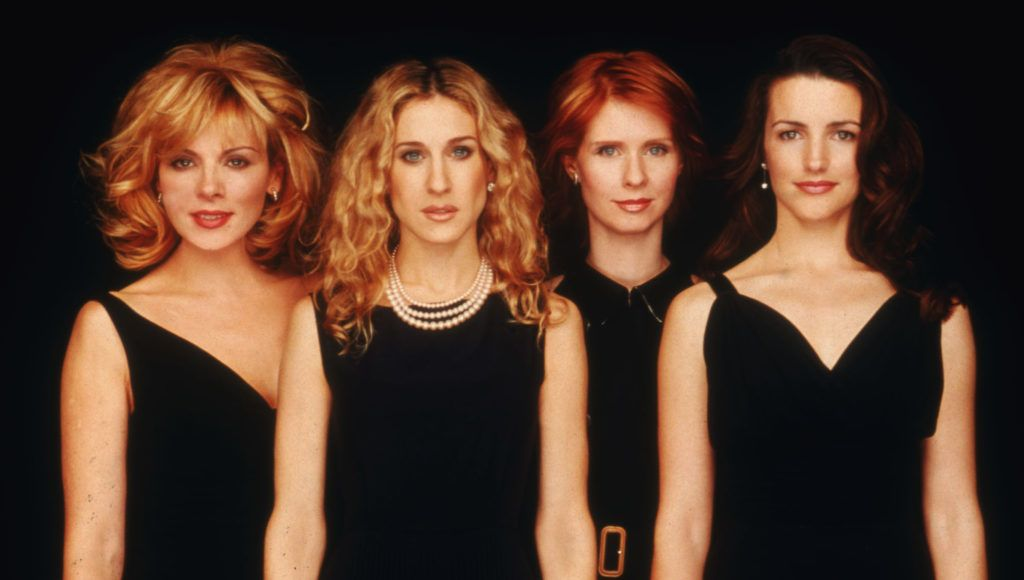"""392326 28: Left to right, actresses Kim Cattrall, Sarah Jessica Parker, Cynthia Nixon, and Kristin Davis pose for a portrait in an undated photo on the set of the HBO series """"Sex and the City."""" (Photo Courtesy of HBO/Getty Images)"""