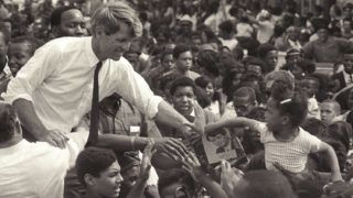 American senator Robert F. Kennedy (1925 - 1968) stands in an open-top convertible and shakes hands with members of a crowd as he campaigns for the democratic Presidential nomination in Detroit, Michigan, May 15, 1968. (Photo by  Andrew Sacks/Getty Images)