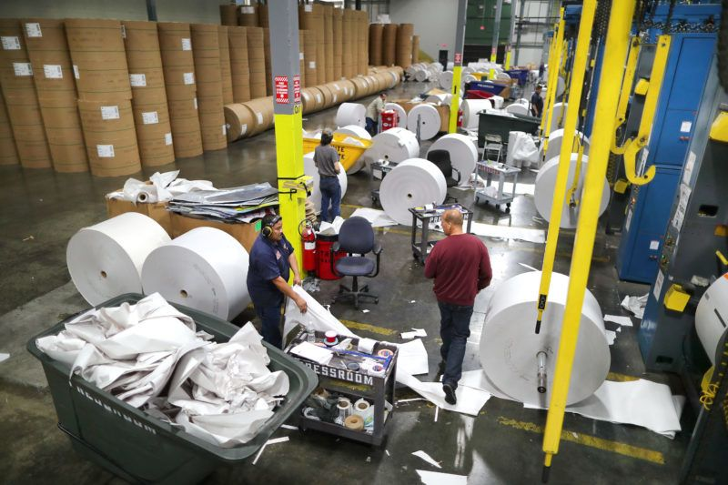 TAUNTON, MA - SEPTEMBER 16: Huge rolls of blank paper are in position to be hoisted onto the presses at The Boston Globe's new printing press in Taunton, MA on Sep. 16, 2017. The new press has been plagued by a host of mechanical problems causing delays in getting the Globe and the other newspapers printed and out the door. (Photo by John Tlumacki/The Boston Globe via Getty Images)