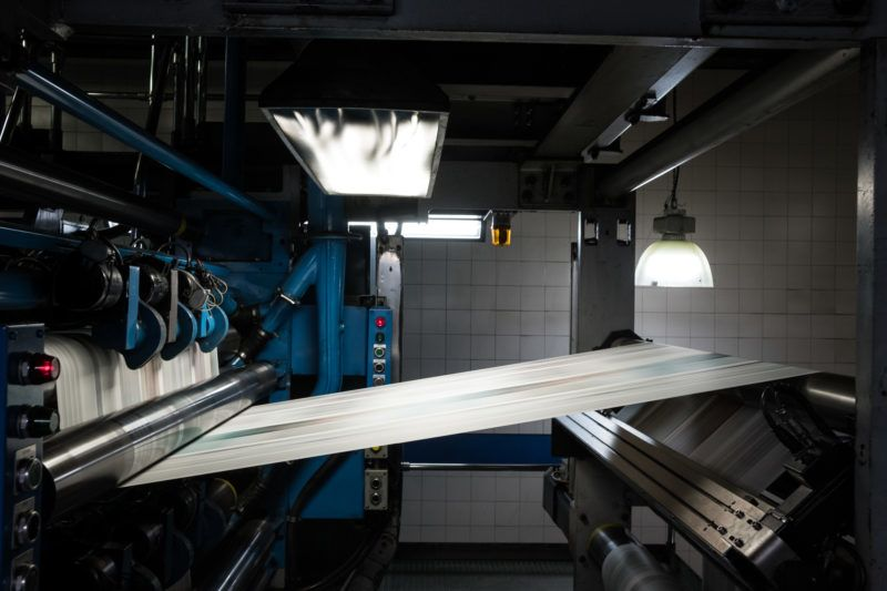 Newsprint passes through a rotary press at the El Tiempo SA printing facility in Bogota, Colombia, on Friday, Dec. 1, 2017. Founded in 1911, El Tiempo is a nationally distributed daily newspaper and has the highest circulation in Colombia. Photographer: Mauricio Palos/Bloomberg via Getty Images