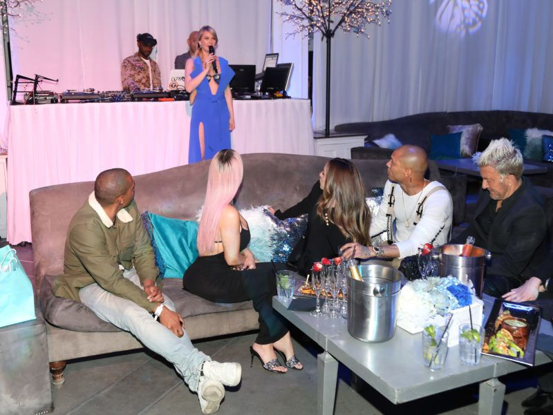 """HOLLYWOOD, CA - MARCH 05:  Kim Kardashian and Jeremy Meeks look on as Marina Acton speaks during the release of Marina Acton's new single """"Fantasize"""" at Boulevard3 on March 5, 2018 in Hollywood, California.  (Photo by Jerritt Clark/Getty Images)"""