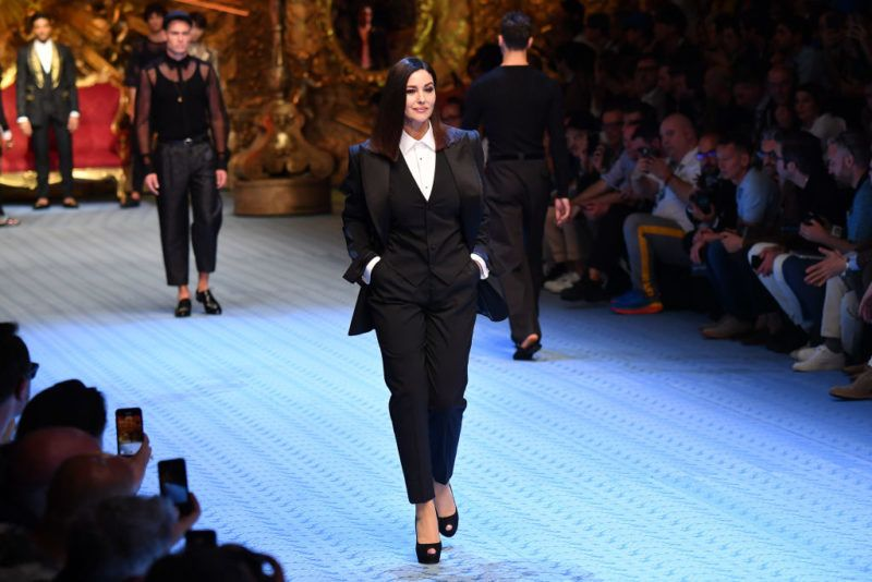 MILAN, ITALY - JUNE 16:  Monica Bellucci walks the runway at the Dolce & Gabbana show during Milan Men's Fashion Week Spring/Summer 2019 on June 16, 2018 in Milan, Italy.  (Photo by Jacopo Raule/Getty Images)