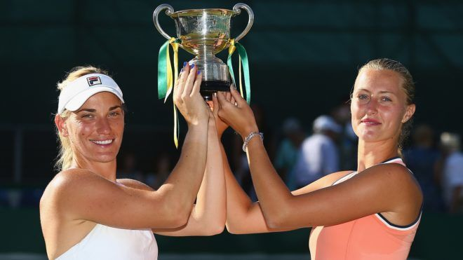 BIRMINGHAM, ENGLAND - JUNE 23: Timea Babos of Hungary and Kristina Mladenovic of France (R) pose with the Trophy after their victory during their doubles Final match against Elise Mertens of Belgium and Demi Schuurs of the Netherlands during day nine of the Nature Valley Classic at Edgbaston Priory Club on June 24, 2018 in Birmingham, United Kingdom. (Photo by Jordan Mansfield/Getty Images for LTA)