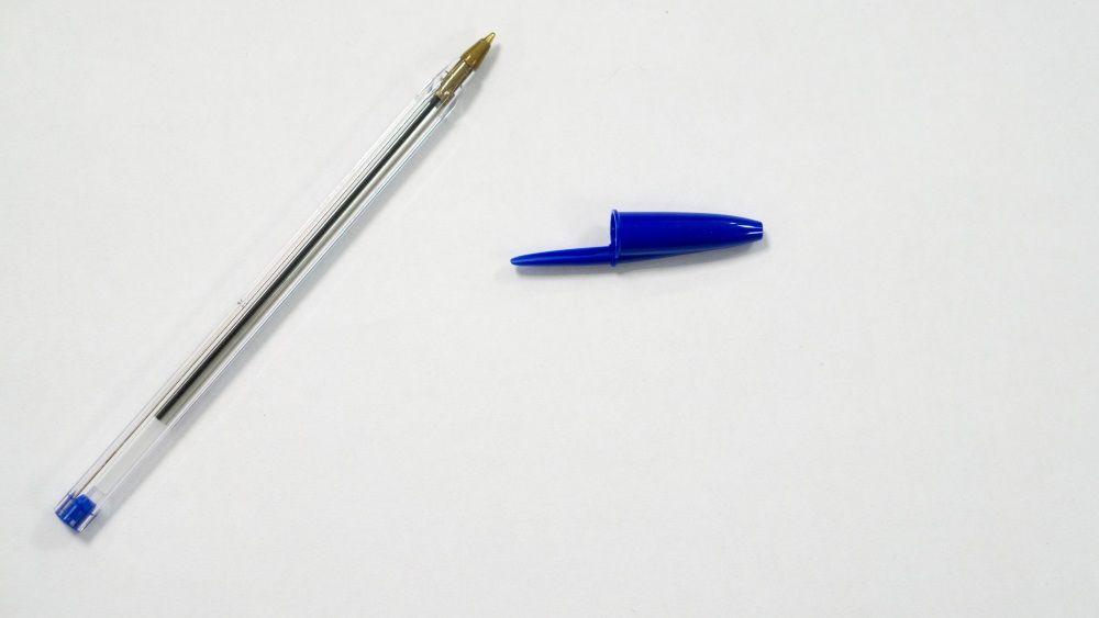 blue pen on white background