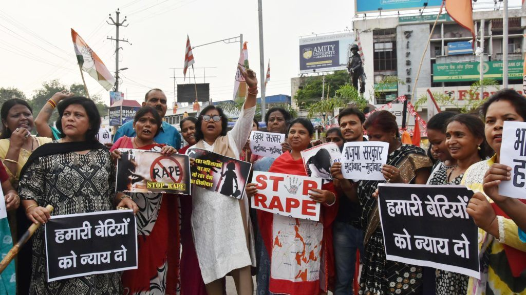 Indian National Congress party activist hold placards and shout slogans during protest against the recent abduction and gang-rape of five charity workers in Chochang village of Khunti district, in Ranchi on June 23, 2018.  Five women working for a charity in remote eastern India were abducted and gang-raped at gunpoint, police said on June 22, in the latest horrific sex assault in the country. / AFP PHOTO / -