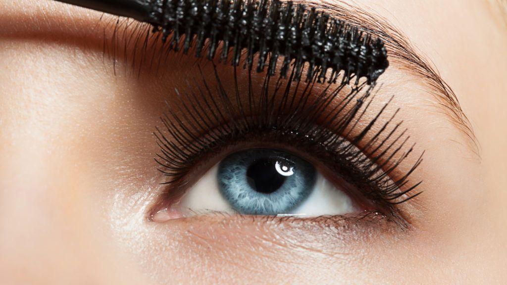 Close-up of make-up blue eye with long lashes with black mascara