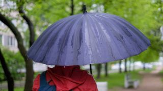 man with umbrella with rain drops
