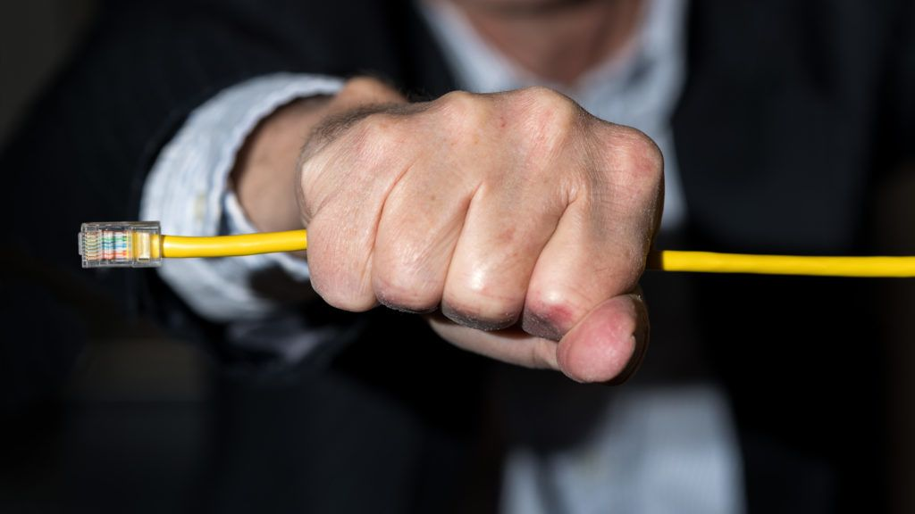 Senior caucasian businessman choking or slowing streaming data in illustration of net neutrality regulations