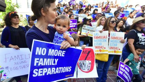 People gather for a rally organized by local families, their supporters and civil rights organizations on the steps of City Hall in Los Angeles, California on June 7, 2018, to protest the federal government's enforcement policy to seperate children from their parents trying to cross the US-Mexico border illegally.  / AFP PHOTO / Frederic J. BROWN