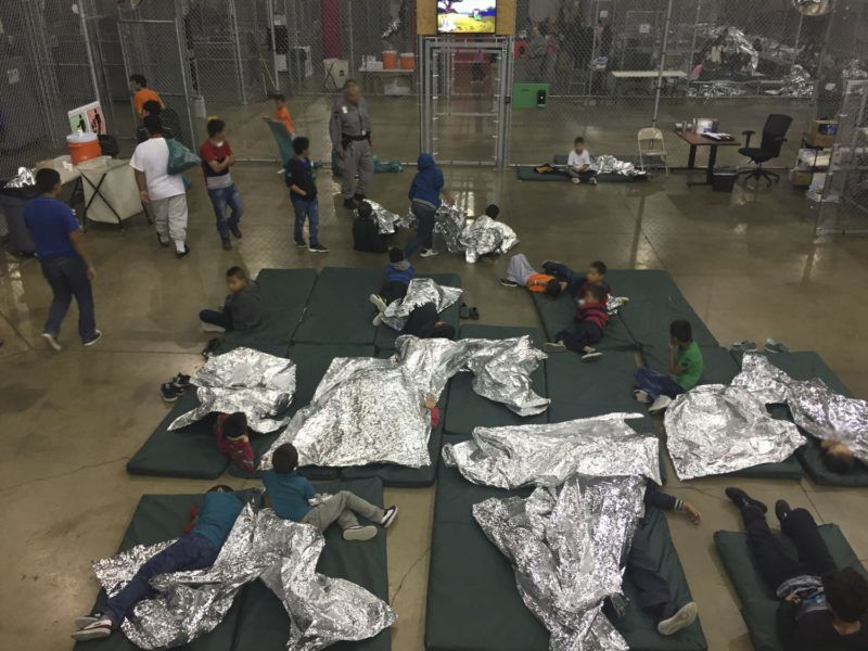 """This US Customs and Border Protection photo dated June 17, 2018 obtained June 18, 2018 shows intake of illegal border crossers by US Border Patrol agents at the Central Processing Center in McAllen, Texas. Children have been taken away from their mothers and fathers in the Border Patrol's South Texas Rio Grande Valley sector, with many brought to the Central Processing Station in McAllen, Texas, since the policy was announced on May 7, according to Manuel Padilla, the Border Patrol sector chief. / AFP PHOTO / US Customs and Border Protection / Handout / RESTRICTED TO EDITORIAL USE - MANDATORY CREDIT """"AFP PHOTO / US CUSTOMS AND BORDER PROTECTION/HANDOUT"""" - NO MARKETING NO ADVERTISING CAMPAIGNS - DISTRIBUTED AS A SERVICE TO CLIENTS   / """"The erroneous mentions appearing in the metadata of this photo by the US Customs and Border Protection has been modified in AFP systems in the following manner: [photo dated June 17, 2018 and obtained June 18, 2018] and not as previously stated. Please immediately remove the erroneous mentions from all your online services and delete them from your servers. If you have been authorized by AFP to distribute them to third parties, please ensure that the same actions are carried out by them. Failure to promptly comply with these instructions will entail liability on your part for any continued or post notification usage. Therefore we thank you very much for all your attention and prompt action. We are sorry for the inconvenience this notification may cause and remain at your disposal for any further information you may require."""""""