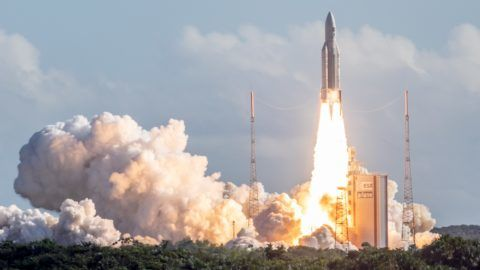 The Ariane 5 rocket, with four Galileo satellites onboard, takes off from the launchpad in the European Space Centre (Europe spaceport) on July 25, 2018 in Kourou, French Guiana. / AFP PHOTO / -