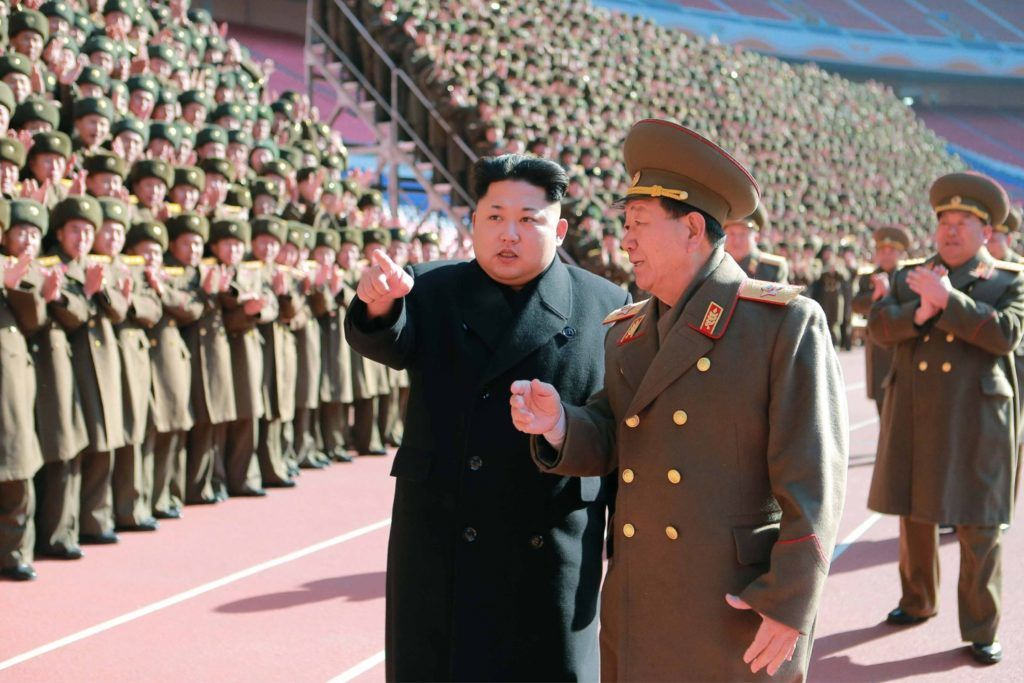 """This undated picture released from North Korea's official Korean Central News Agency (KCNA) on February 2, 2015 shows North Korean leader Kim Jong-Un (centre L) speaking with Hwang Pyong-So (centre R) as he meets with the participants in the meeting of military and political cadres for summing up the results of construction in 2014 and merited persons in the Korean People's Army (KPA) who contributed to the construction of major projects at an undisclosed location in North Korea.   AFP PHOTO / KCNA via KNS    REPUBLIC OF KOREA OUT THIS PICTURE WAS MADE AVAILABLE BY A THIRD PARTY. AFP CAN NOT INDEPENDENTLY VERIFY THE AUTHENTICITY, LOCATION, DATE AND CONTENT OF THIS IMAGE. THIS PHOTO IS DISTRIBUTED EXACTLY AS RECEIVED BY AFP. ---EDITORS NOTE--- RESTRICTED TO EDITORIAL USE - MANDATORY CREDIT """"AFP PHOTO / KCNA VIA KNS"""" - NO MARKETING NO ADVERTISING CAMPAIGNS - DISTRIBUTED AS A SERVICE TO CLIENTS / AFP PHOTO / KCNA / KNS"""