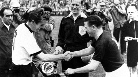 Fritz Walter and Puscas are exchanging pennants, 1954 FIFA World Cup, final, Germany - Hungary 3:2