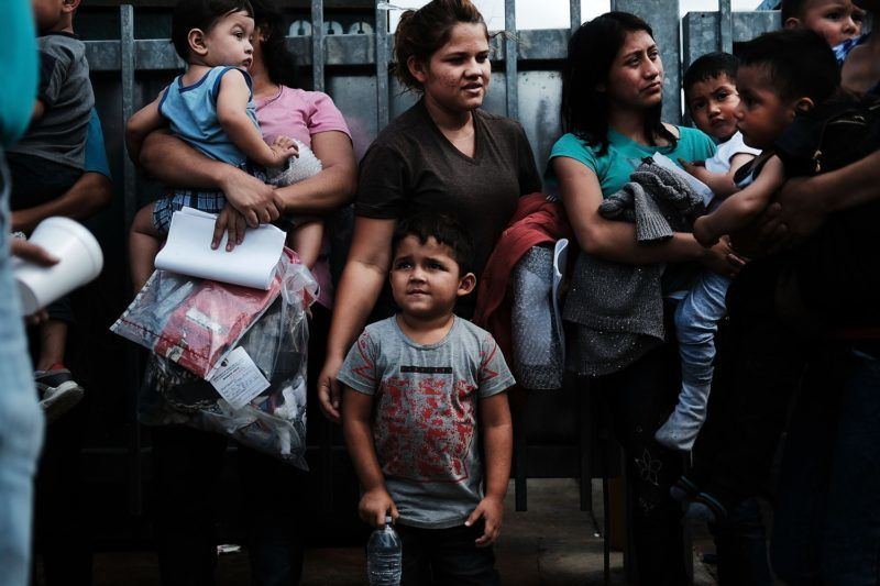 MCALLEN, TX - JUNE 22: Dozens of women and their children, many fleeing poverty and violence in Honduras, Guatamala and El Salvador, arrive at a bus station following release from Customs and Border Protection on June 22, 2018 in McAllen, Texas. Once families and individuals are released and given a court hearing date they are brought to the Catholic Charities Humanitarian Respite Center to rest, clean up, enjoy a meal and to get guidance to their next destination. Before President Donald Trump signed an executive order Wednesday that halts the practice of separating families who are seeking asylum, over 2,300 immigrant children had been separated from their parents in the zero-tolerance policy for border crossers.   Spencer Platt/Getty Images/AFP