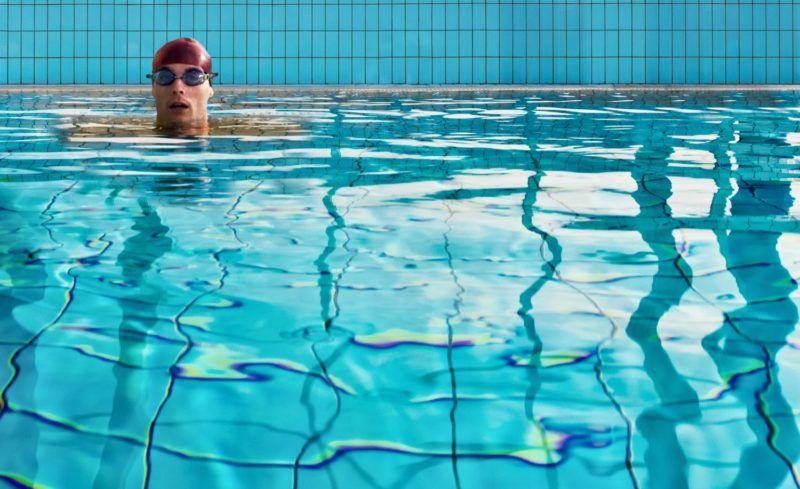 Man swimming in indoor pool