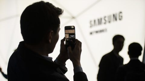 BARCELONA, SPAIN - FEBRUARY 26: A man takes photos at the Samsung stand at the Mobile World Congress (MWC), the world's biggest mobile fair, on February 26, 2018 in Barcelona, Spain.  Lola Bou / Anadolu Agency