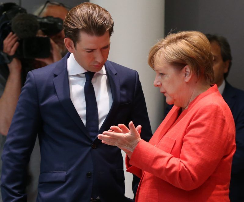 BRUSSELS, BELGIUM - JUNE 29: German Chancellor Angela Merkel (R) chats with Austrian Prime Minister Sebastian Kurz (L) during the second day of the European Union Leaders' Summit in Brussels, Belgium on June 29, 2018.   Dursun Aydemir / Anadolu Agency