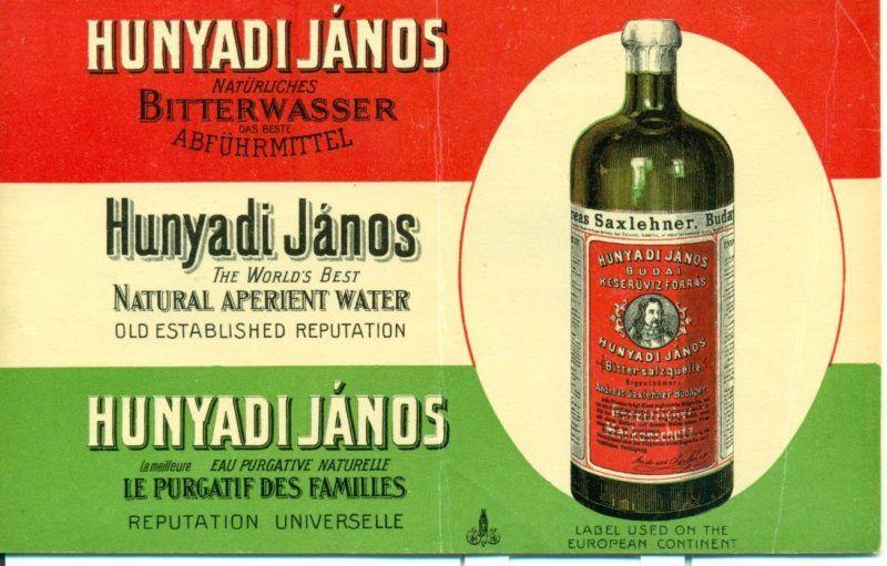 Nemzeti színű alapon feliratok és egy ásványvizes üveg a jobb oldalon ovális keretben. A későbbi Hunyadi János ásványvíz forrását 1862-ben találta meg Bayer János, aki eladta Saxlehner András posztókereskedőnek. Az új tulajdonos korszerű palackozó üzemet építtetett és 1877-ben védjegyeztette a Hunyadi János keserűvizet. Az a XX. század elejére világhírűvé vált, külföldre is szállították és túlélte az államosítást és a privatizációt is.