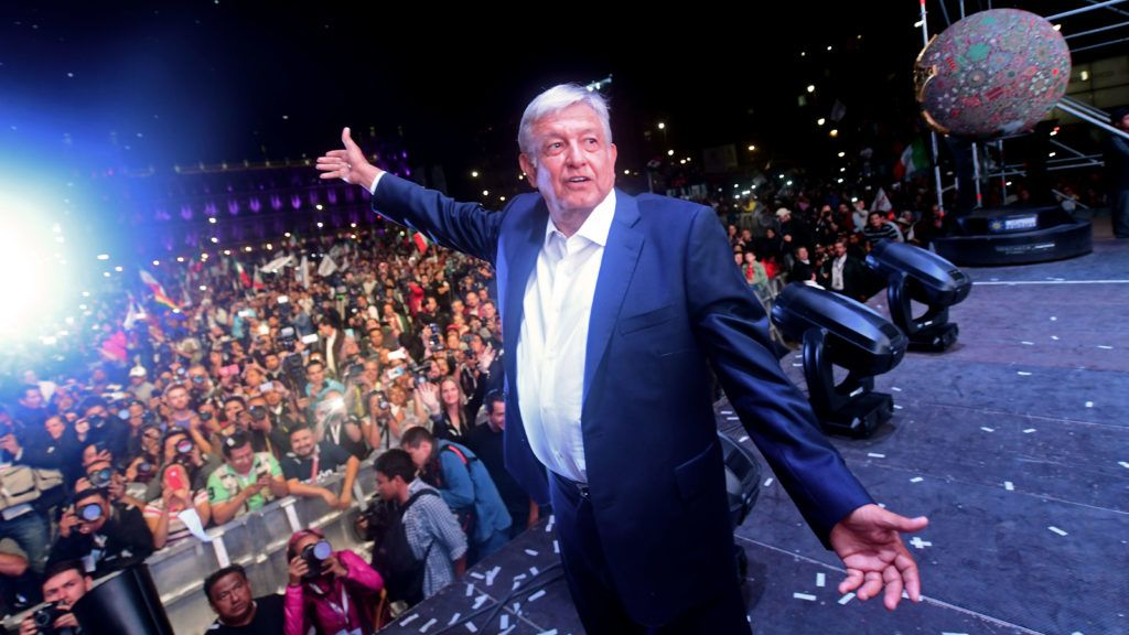 """Newly elected Mexico's President Andres Manuel Lopez Obrador, running for """"Juntos haremos historia"""" party, cheers his supporters at the Zocalo Square after winning general elections, in Mexico City, on July 1, 2018. / AFP PHOTO / PEDRO PARDO"""