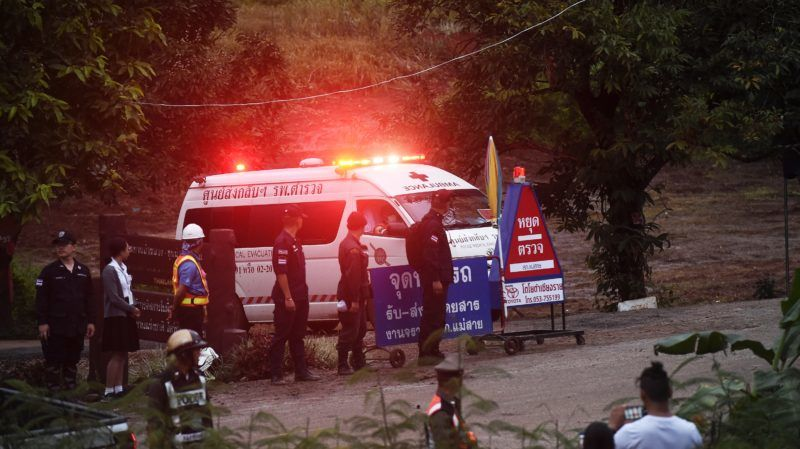 An ambulance leaves the Tham Luang cave area after divers evacuated some of the 12 boys and their coach trapped at the cave in Khun Nam Nang Non Forest Park in the Mae Sai district of Chiang Rai province on July 8, 2018. Elite divers on July 8 began the extremely dangerous operation to extract 12 boys and their football coach who have been trapped in a flooded cave complex in northern Thailand for more than two weeks, as looming monsoon rains threatened the rescue effort. / AFP PHOTO / LILLIAN SUWANRUMPHA /