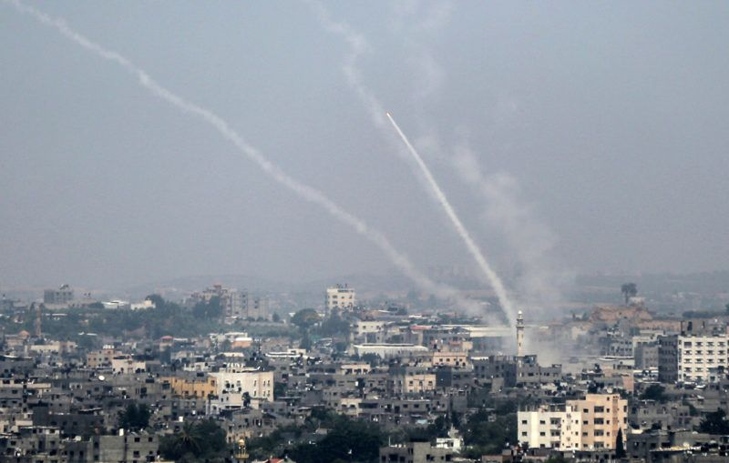 A picture taken on July 14, 2018 shows Palestinian rockets being fired from Gaza City towards Israel. Israel's military said it had launched air strikes targeting Hamas in the Gaza Strip on July 14 as rockets and mortars were lobbed into southern Israel from the blockaded Palestinian enclave. / AFP PHOTO / Bashar TALEB