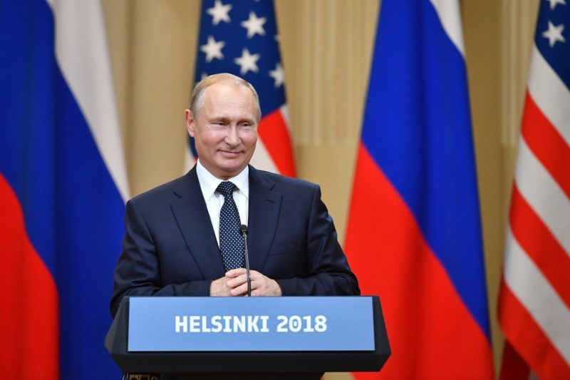 """Russia's President Vladimir Putin smiles during a joint press conference with US President after a meeting at the Presidential Palace in Helsinki, on July 16, 2018. The US and Russian leaders opened an historic summit in Helsinki, with Donald Trump promising an """"extraordinary relationship"""" and Vladimir Putin saying it was high time to thrash out disputes around the world.  / AFP PHOTO / Yuri KADOBNOV"""