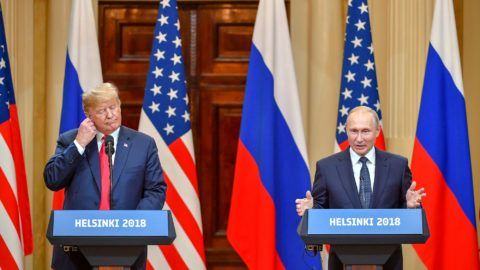 """US President Donald Trump (L) and Russia's President Vladimir Putin attend a joint press conference after a meeting at the Presidential Palace in Helsinki, on July 16, 2018. The US and Russian leaders opened an historic summit in Helsinki, with Donald Trump promising an """"extraordinary relationship"""" and Vladimir Putin saying it was high time to thrash out disputes around the world.  / AFP PHOTO / Yuri KADOBNOV"""