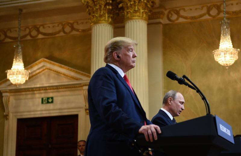 """US President Donald Trump (L) and Russia's President Vladimir Putin attend a joint press conference after a meeting at the Presidential Palace in Helsinki, on July 16, 2018. The US and Russian leaders opened an historic summit in Helsinki, with Donald Trump promising an """"extraordinary relationship"""" and Vladimir Putin saying it was high time to thrash out disputes around the world.  / AFP PHOTO / Brendan Smialowski"""